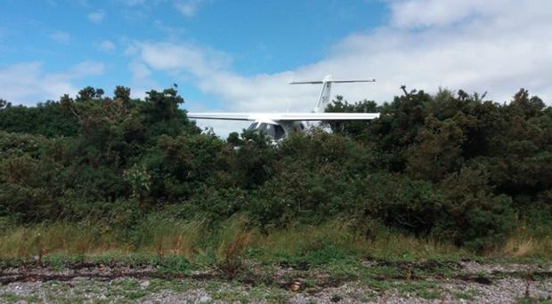 The Extra 400 aircraft overran into the airfield boundary fence (Air Accidents Investigation Branch/PA)