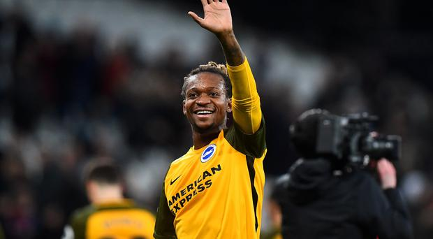 Brighton and Hove Albion's Gaetan Bong waves to the fans after the Premier League match at the London Stadium.