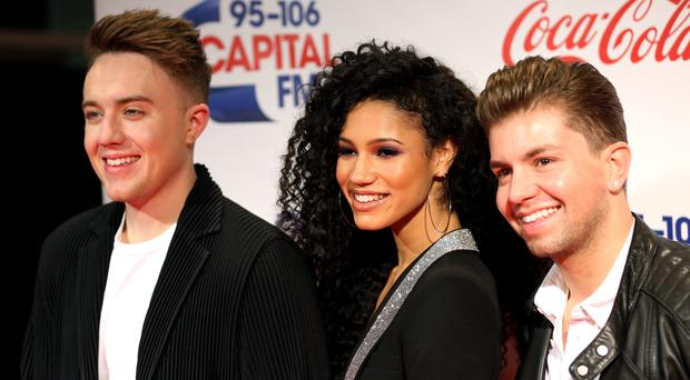 Roman Kemp, left, Vick Hope and Sonny Jay will host the new UK-wide breakfast show (David Parry/PA)