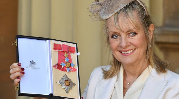 """Lesley """"Twiggy"""" Lawson holds her Dame Commander of the Order of the British Empire award (John Stillwell/PA)"""