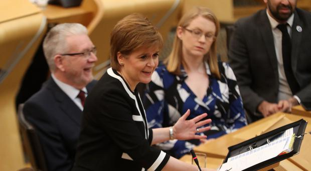 Nicola Sturgeon called on Theresa May to 'change course' on Brexit (Andrew Milligan/PA)
