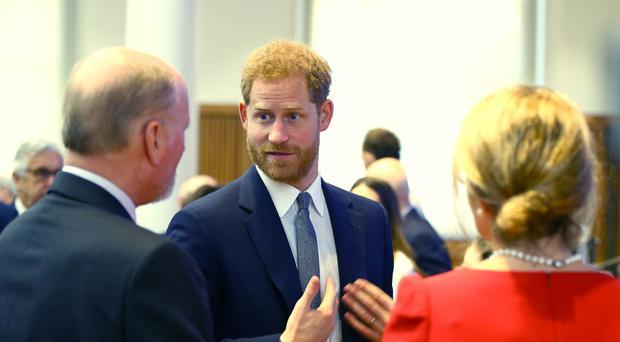 The Duke of Sussex talks with guests during the Veterans' Mental Health Conference (Gareth Fuller/PA)