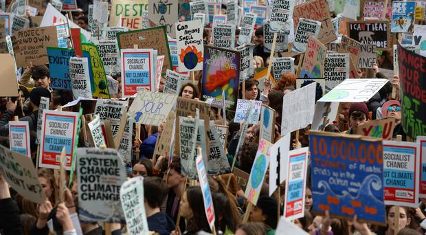Students take part in a global school strike for climate change in Parliament Square (Kirsty O'Connor/PA)