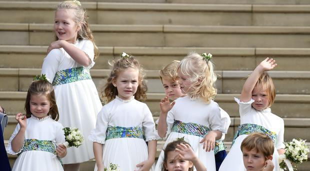 The bridesmaids and page boys, including Princess Charlotte, Savannah Phillips, Maud Windsor, Prince George, Isla Phillips and Mia Tindall, at the royal wedding (Toby Melville/PA)