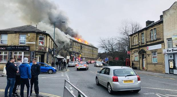 Picture taken with permission from the Twitter feed of @asifbymajic of firefighters tackling a blaze ('asifbymagic/PA)