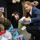 The Duke of Sussex speaks to six-year-old Stella during a visit to St Vincent's Catholic Primary School, Acton (Alastair Grant/PA)