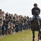 Competitors heading to the finish of the Kiplingcotes Derby, East Yorkshire (PA)