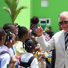 The Prince of Wales greets schoolchildren as he arrives at Argyle International Airport, St Vincent and the Grenadines (Jane Barlow/PA)