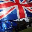 The Union and EU flags in Westminster (Yui Mok/PA)