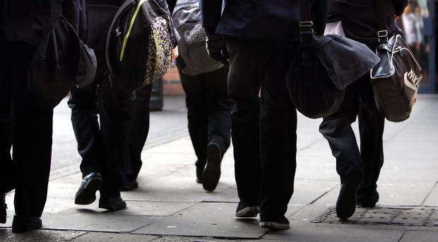 One in five school staff here are assaulted once a week, a survey has revealed. (PA)