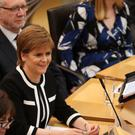 Nicola Sturgeon was pressed about a second independence referendum at First Minister's Questions (Andrew Milligan/PA)