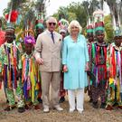 The Prince of Wales and the Duchess of Cornwall walk through Basseterre town in St Kitts and Nevis (Phil Noble/PA)