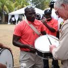 The Prince of Wales tries out a drum (Jane Barlow/PA)
