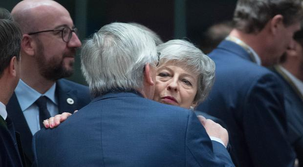 Prime Minister Theresa May is greeted by President of the European Commission Jean-Claude Juncker in Brussels (Stefan Rousseau/PA)