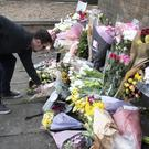 Floral tributes and messages have been left for the tragic student (Danny Lawson/PA)