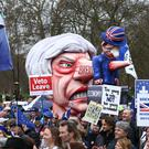 Anti-Brexit campaigners before they take part in the People's Vote March in London (Aaron Chown/PA)