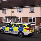 Police in Viola Avenue in Stanwell, Surrey (Steve Parsons/PA)