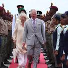The Prince of Wales and the Duchess of Cornwall arrive at Maurice Bishop International Airport (Jane Barlow/PA)
