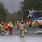 Passengers rescued from the Viking Sky cruise ship are helped from a helicopter in Hustadvika (Odd Roar Lange/NTB Scanpix via AP)