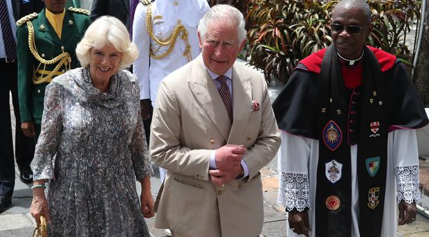 The Prince of Wales and the Duchess of Cornwall arrive to attend a church service at St Michael's Cathedral in Bridgetown, Barbados (Jane Barlow/PA)