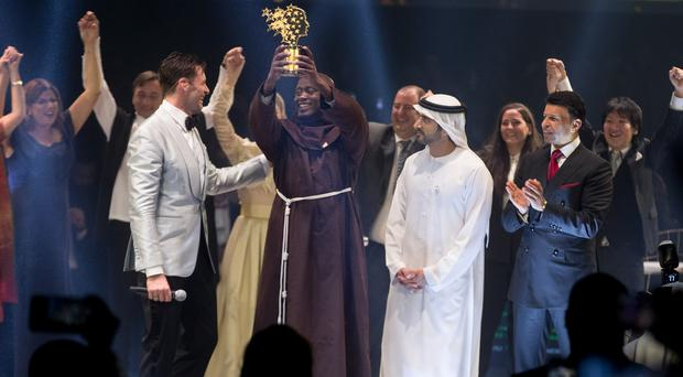 Peter Tabichi after he was awarded the Varkey Foundation Global Teacher Prize at a ceremony in Dubai hosted by Hollywood star Hugh Jackman (Varkey Foundation/PA)