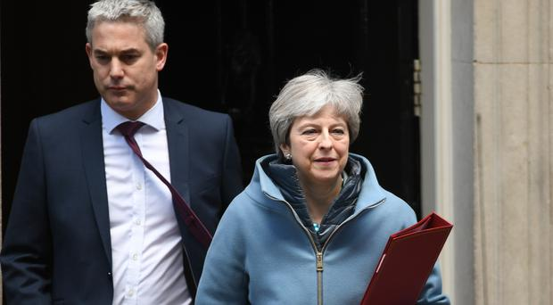 Brexit Secretary Stephen Barclay and Prime Minister Theresa May leave 10 Downing Street, after a Cabinet meeting (Stefan Rousseau/PA)