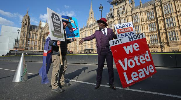 Protestors both for and against Brexit face off outside Westminster (Jonathan Brady/PA)
