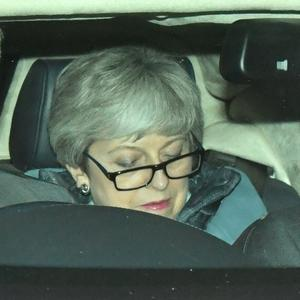 Theresa May leaves the House of Commons following the key Brexit votes (Dominic Lipinski/PA)