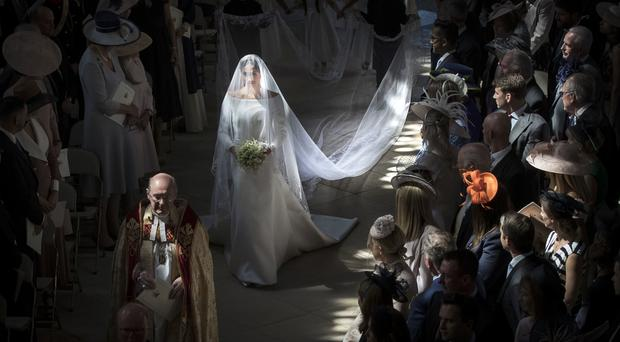 Meghan Markle walks down the aisle as she arrives in St George's Chapel (Danny Lawson/PA)
