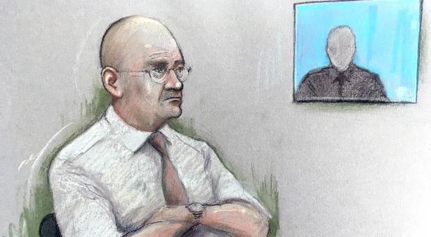 Court artist sketch of Bob Higgins watching a witness interview in the dock at Salisbury Crown Court (Elizabeth Cook/PA)