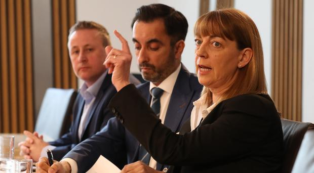 Linda and Stuart Allan, the parents of Katie Allan, and their lawyer Aamer Anwar (centre) have called for action to tackle prison deaths (Andrew Milligan/PA)