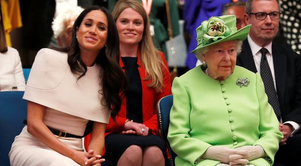 Meghan is tipped to choose the name Elizabeth for a girl in honour of the Queen (Phil Noble/PA)