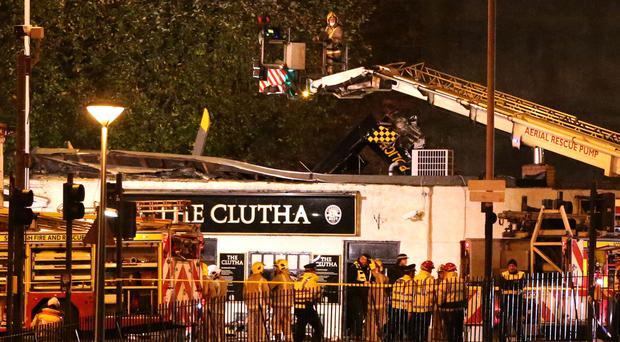 Emergency services at the scene of the police helicopter crash at the Clutha Bar in Glasgow in 2013 (Andrew Milligan/PA)