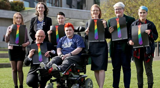 Deputy First Minister John Swinney (front left) and Minister for Higher and Further Education Shirley-Anne Somerville (third from right) with representatives from the TIE campaign and LGBT Youth Scotland outside the Scottish Parliament (Jane Barlow/PA)