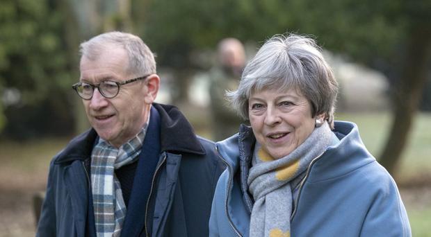 Theresa May and her husband Philip after attending a church service (Steve Parsons/PA)