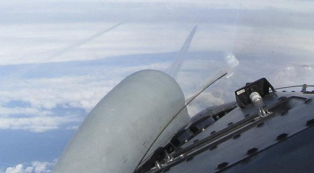 A picture taken from an RAF Typhoon aircraft of two Russian Blackjack Tupolev Tu-160 long range bombers, seen here in the distance (MoD/PA)