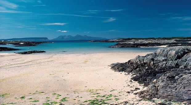 The scene towards Skye at Camusdarach beach in the Highlands (Paul Tomkins/VisitScotland/PA)