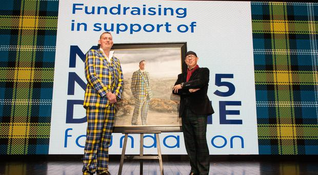 Doddie Weir in front of a life-sized photo of him with artist Gerard Burns (Veronica Sanchis/PA)