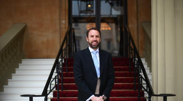 England football manager Gareth Southgate arrives for his investiture ceremony at Buckingham Palace, London.
