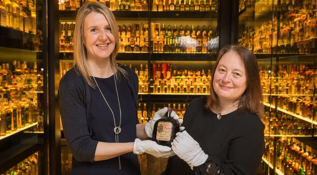Susan Morrison (left), of the Scotch Whisky Experience, and Diageo archivist Christine McCafferty (Diageo/PA)
