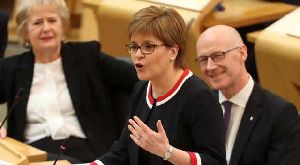First Minister Nicola Sturgeon in the debating chamber during First Minister's Questions (Andrew Milligan/PA)