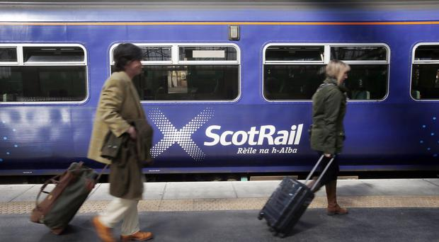Passengers fainted on an overcrowded ScotRail train (Danny Lawson/PA)