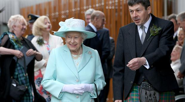 The Queen with Ken Macintosh, Presiding Officer of the Scottish Parliament, in 2016 (Jane Barlow/PA)