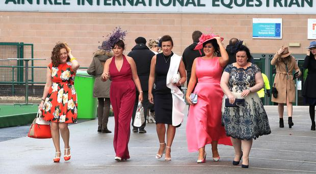 Racegoers arrive for Ladies Day of the 2019 Randox Health Grand National Festival at Aintree Racecourse (Peter Byrne/PA)