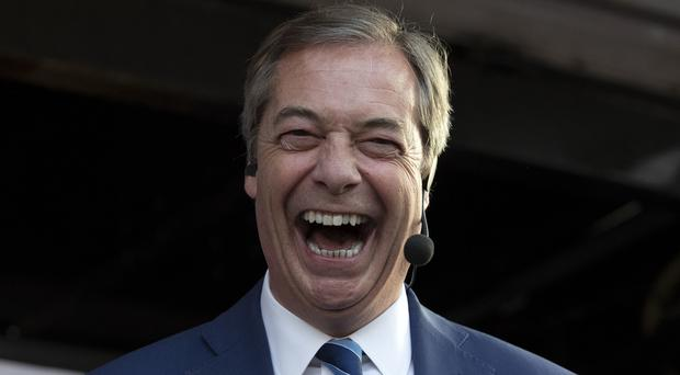Nigel Farage said he would not watch British politicians 'roll us over' (Steve Parsons/PA)