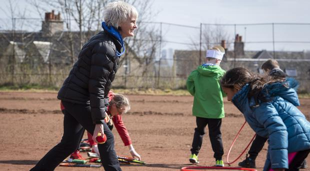 Judy Murray giving children tennis training in Maryhill Park, Glasgow, as part of her work with the Judy Murray Foundation (John Linton/PA)
