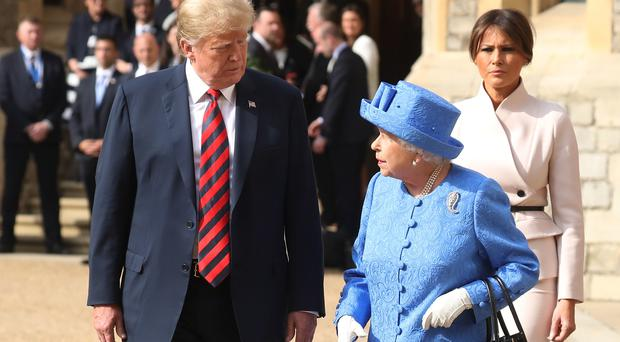 Mr Trump and his wife are welcomed by the Queen to Windsor Castle (Chris Jackson/PA)