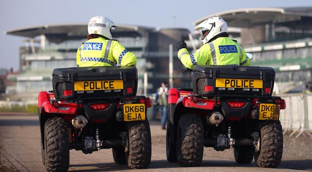 Police on patrol at Aintree (Nigel French/PA)