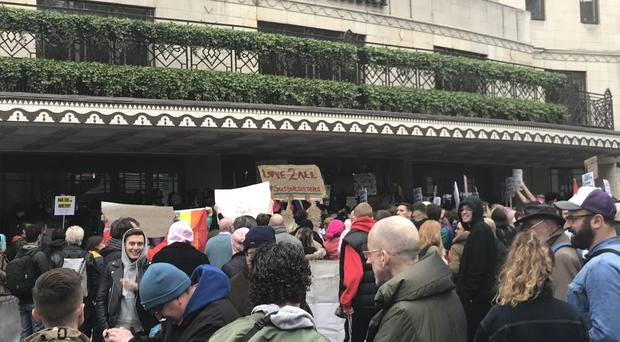 Protesteers outside the front door of the Dorchester Hotel in Park Lane (Joe Gammie/PA)