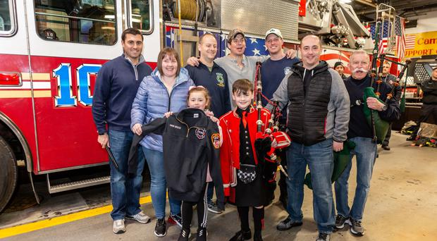Piper Josh Bruce with his personalised jacket from the New York Fire Department (New York Tartan Week/PA)